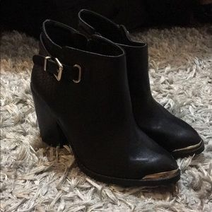 Black booties with gold trim